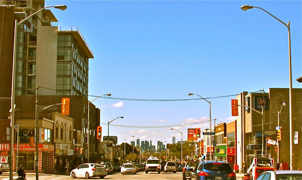 Danforth and Woodbine, looking west on Sept. 16, 2014, 98 year and 51 weeks after the photo below right, Woodbine and Danforth has changed plenty. And after about 60 years in decline, the area is getting new investment and is clearly on the way back.