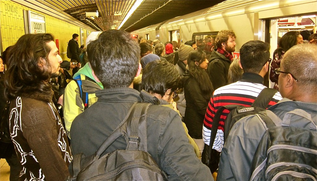 After letting four thoroughly jammed trains pass on Nov. 24, 2014, late in the afternoon, I ditched the politeness and squeezed aboard one. The day began with having to let two jammed trains go at Coxwell, and we left large crowds on nearly every platform west to Yonge.
