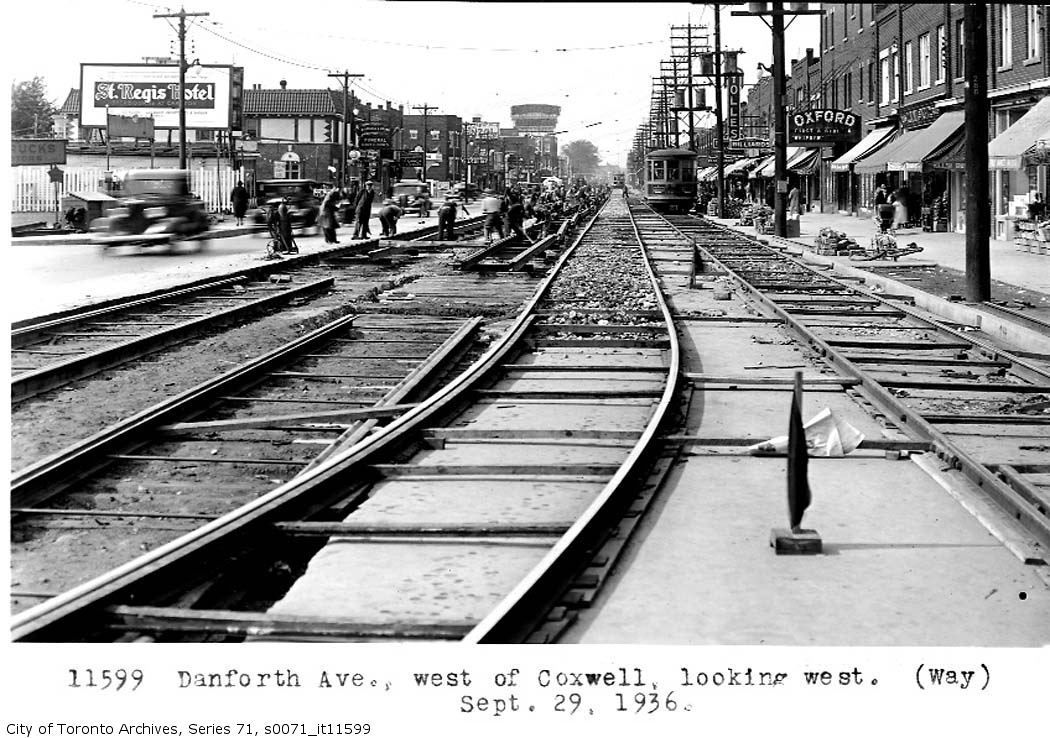 Looking west at track replacement in the fall of 1936. Note the Oxford Theatre and the need to use temporary tracks.
