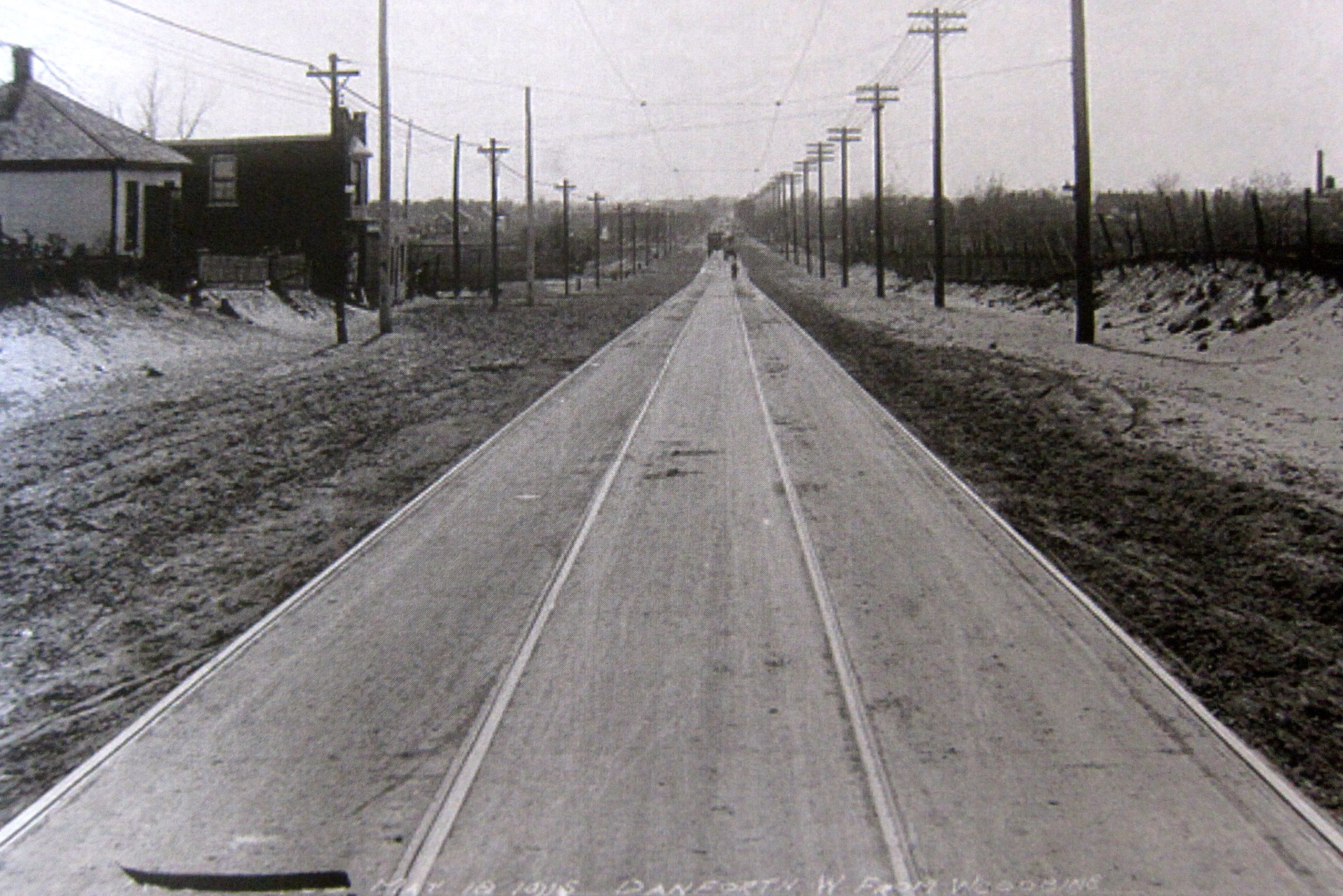 Looking west from Woodbine and Danforth in 1915, with fresh streetcar tracks and the overhead wires completed. Streetcars ran on this stretch for 51 years before being replace by the subway.
