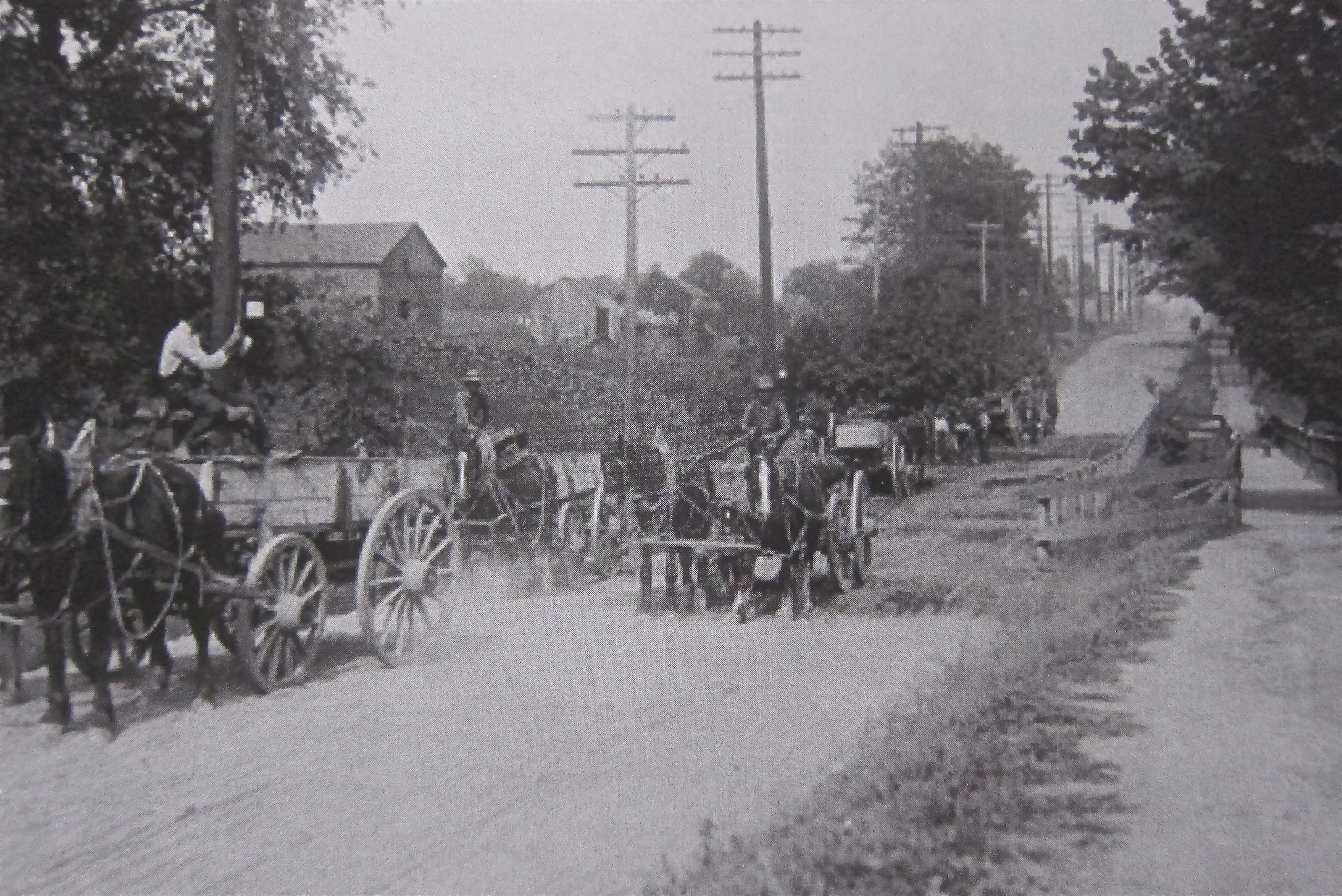 As late as 1912, just before work began to bring streetcar tracks and paving were brought to the East Danforth, farmers still had to rely on rickety wooden bridges to cross the creeks on the muddy Second Concession Road.