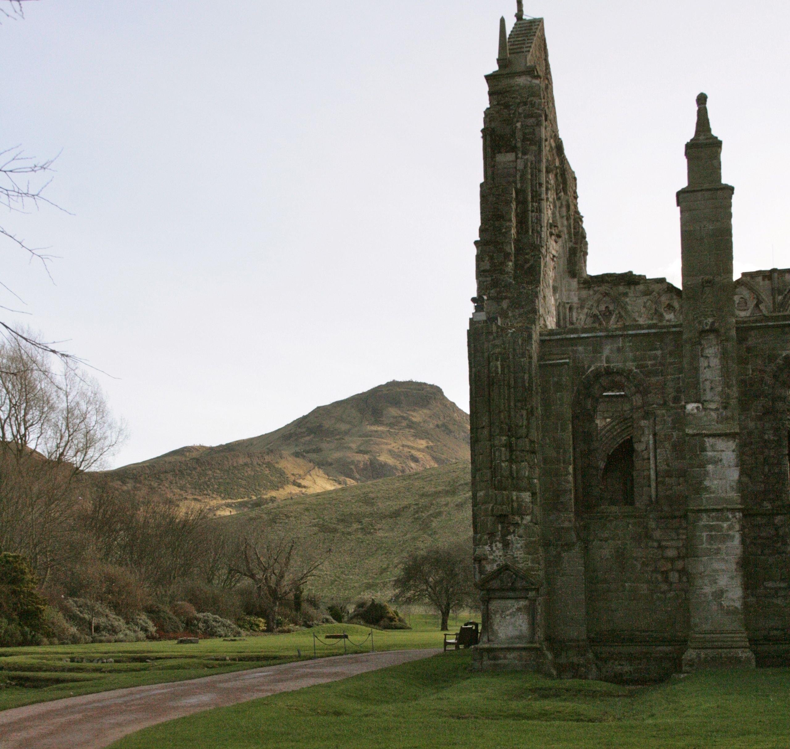 Arthur's Seat lies in the distance, seen from the abbey ruins behind  Holyrood Castle.